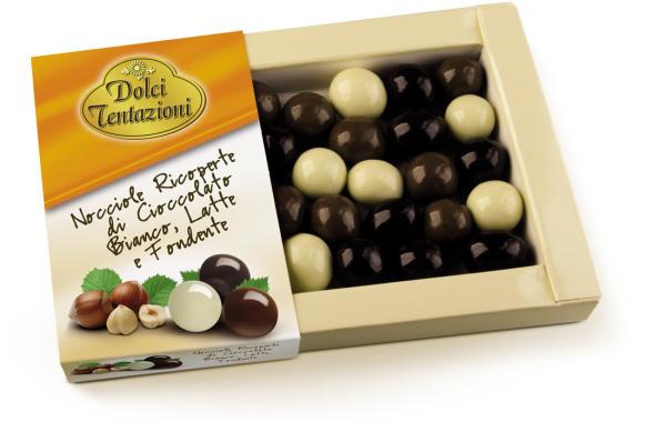 Nocciole ricoperte di cioccolato bianco, al latte e fondente